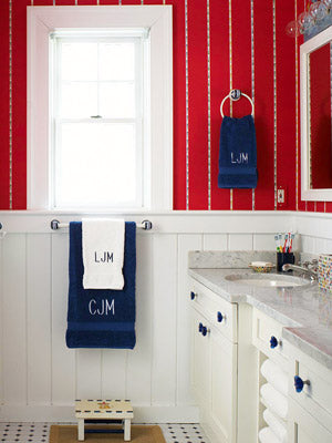 red and white striped bathroom walls with white wainscoting, white and blue towels, white cabinets... American Inspired Red, White & Blue Bathrooms from Bathroom Bliss by Rotator Rod