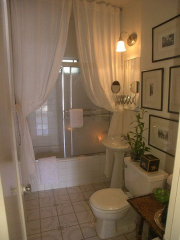 small but beautiful white bathroom with double white shower curtains... Bathroom Decor Ideas: Luxurious Shower Curtains from Bathroom Bliss by Rotator Rod