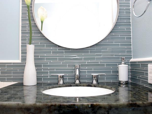 beautiful bathroom vanity with dark gray glass tile, granite top, round mirror, & flower... Bathroom Design Trends: Gorgeous Gray Inspiration