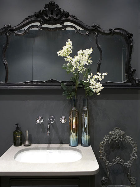 dramatic dark gray bathroom with black framed mirror & white flowers... Bathroom Design Trends: Gorgeous Gray Inspiration