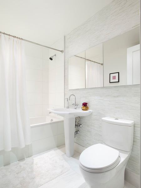 beautiful light gray bathroom with tile & white shower curtain... Bathroom Design Trends: Gorgeous Gray Inspiration