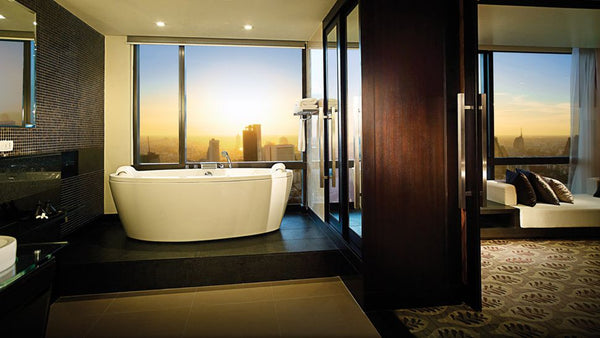 luxurious bathroom with freestanding bathtub, dark wood and tile accents and downtown Bangkok, Thailand, view... Beautiful Bathroom Inspiration: Big City Style
