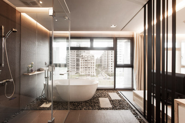 modern zen-inspired bathroom with rock garden, freestanding bathtub, shower, and city views of downtown Taiwan... Beautiful Bathroom Inspiration: Big City Style
