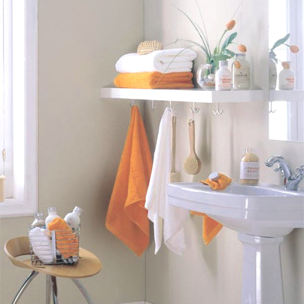 cute white bathroom with orange hand towels and flowers... Beautiful Bathroom Inspiration: Fall Decorating Ideas from Bathroom Bliss by Rotator Rod