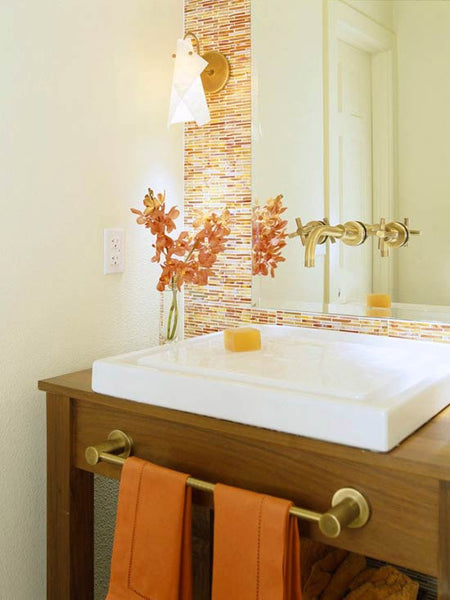 Lovely White Bathroom With Orange Mosaic Backsplash, Orange Hand Towels And  Flowers.