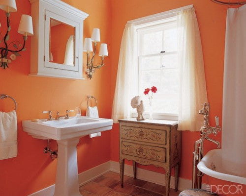 orange bathroom balanced with white accessories and curtains... Beautiful Bathroom Inspiration: Orange Bathrooms from The Bathroom Bliss Blog by Rotator Rod, the original curved shower rod that rotates!