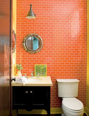 small but sophisticated orange bathroom with orange subway tile... Beautiful Bathroom Inspiration: Orange Bathrooms from The Bathroom Bliss Blog by Rotator Rod, the original curved shower rod that rotates!