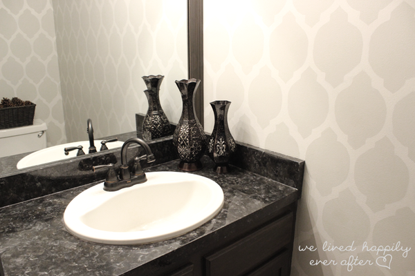 beautiful gray bathroom with DIY faux granite... Easy Bathroom Updates for a More Luxurious Rental Apartment