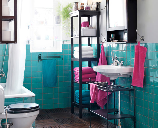 fun small teal and pink bathroom with extra storage space...  Give the Gift of Bathroom Space for the Holidays from Bathroom Bliss by Rotator Rod