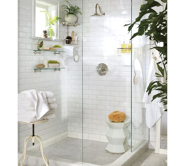 beautiful white shower with subway tile, floating shower caddies, plants, luxurious bathroom products... Give the Gift of Bathroom Space for the Holidays from Bathroom Bliss by Rotator Rod