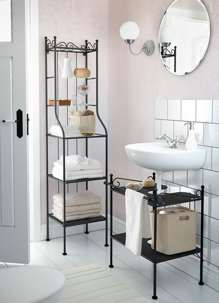 feminine light pink and white bathroom with floating sink, cast iron shelving units...  Give the Gift of Bathroom Space for the Holidays from Bathroom Bliss by Rotator Rod