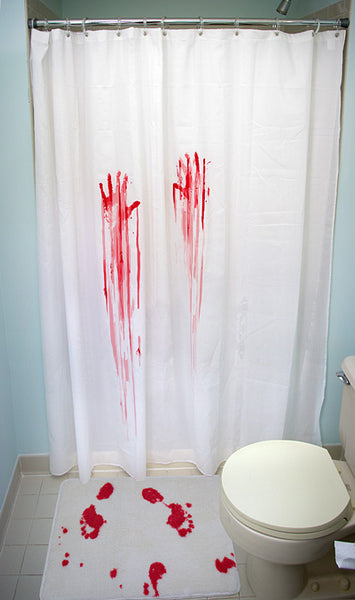 bathroom with bloody murder scene shower curtain and bath mat... Halloween Decorating Ideas for Small Bathrooms from Bathroom Bliss by Rotator Rod