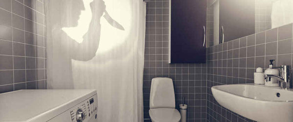gray bathroom with creepy, knife-wielding shadow shower curtain... Halloween Decorating Ideas for Small Bathrooms from Bathroom Bliss by Rotator Rod
