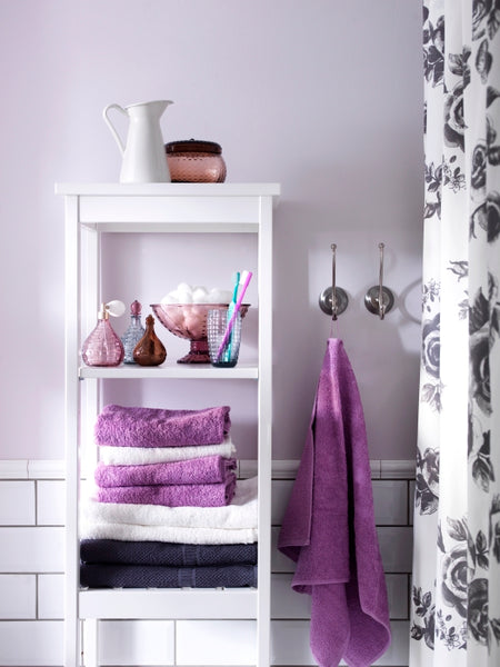 white and gray bathroom with subway tile and fun purple accents, towels, shower curtain... Hottest Space-Saving Bathroom Trends for 2015 from The Bathroom Bliss Blog