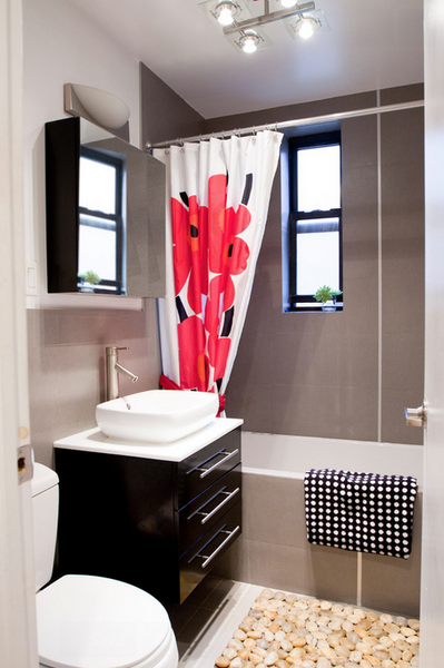 gray and white bathroom with black vanity and patterned shower curtain, bath rug, towels... Hottest Space-Saving Bathroom Trends for 2015 from The Bathroom Bliss Blog