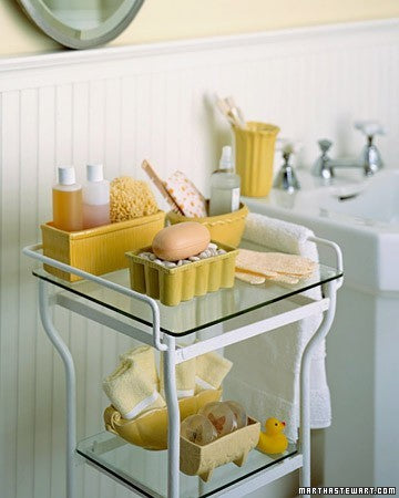 cute yellow and white bathroom shelves full of guest bathroom essentials... Prepare for Holiday House Guests with a Well Stocked Guest Bathroom from The Bathroom Bliss Blog by Rotator Rod