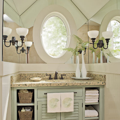 big beautiful guest bathroom with mirrors, granite, green cabinet with exposed shelves... Prepare for Holiday House Guests with a Well Stocked Guest Bathroom from The Bathroom Bliss Blog by Rotator Rod