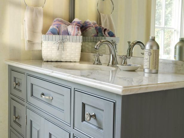 gray guest bathroom vanity with marble top, basket of hand towels... Prepare for Holiday House Guests with a Well Stocked Guest Bathroom from The Bathroom Bliss Blog by Rotator Rod