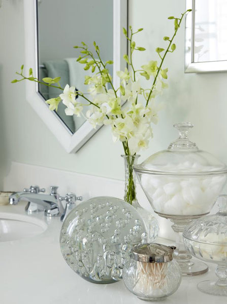 white and gray bathroom vanity with glass jars filled with bathroom essentials... Prepare for Holiday House Guests with a Well Stocked Guest Bathroom from The Bathroom Bliss Blog by Rotator Rod