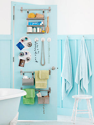 stylish light blue small bathroom with clever storage solution of putting hooks on the back of the door... Inspiration in Rotation: Summer-Inspired Bathrooms from Bathroom Bliss by Rotator Rod