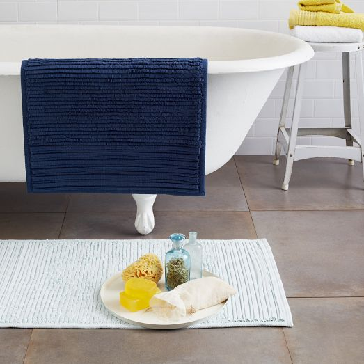 solid color pleated stripe bath mat... Nautical Bath Mats Perfect for a Seaside Summer from Bathroom Bliss by Rotator Rod