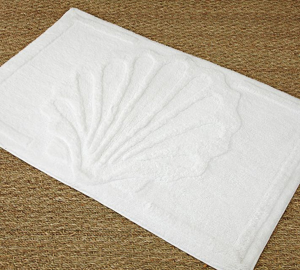 white shell sculpted bath rug... Nautical Bath Mats Perfect for a Seaside Summer from Bathroom Bliss by Rotator Rod