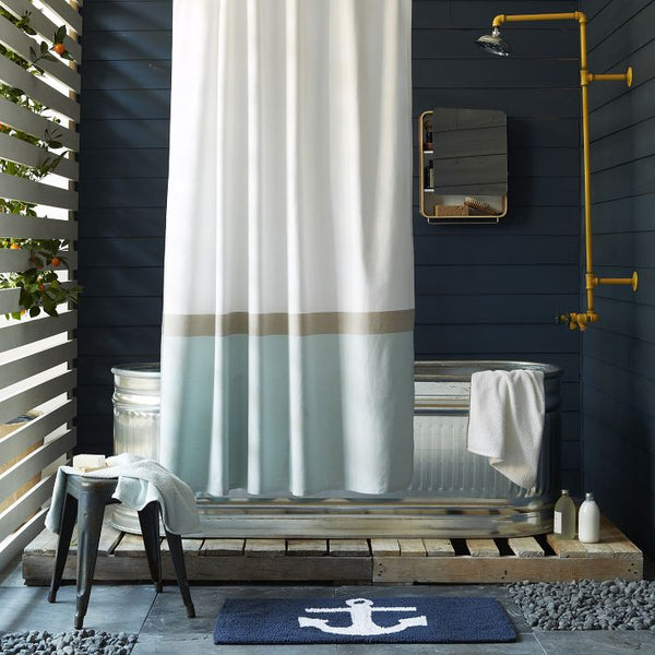 eclectic bathroom with tin freestanding bathtub, pale shower curtain, boat anchor bath mat... Nautical Bath Mats Perfect for a Seaside Summer from Bathroom Bliss by Rotator Rod
