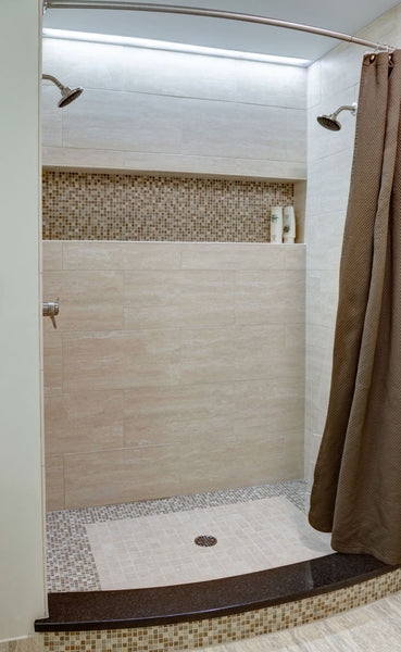 luxurious beige shower with built in shelf & curved shower rod... Quick Fix Bathroom Ideas: Expand Shower Space Easily with a Curved Shower Rod from Bathroom Bliss by Rotator Rod