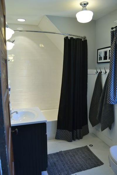 beautiful black & white bathroom with a curved shower curtain rod... Quick Fix Bathroom Ideas: Expand Shower Space Easily with a Curved Shower Rod from Bathroom Bliss by Rotator Rod