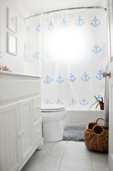 chic beach cottage bathroom with anchor shower curtain on a curved shower rod... Quick Fix Bathroom Ideas: Expand Shower Space Easily with a Curved Shower Rod from Bathroom Bliss by Rotator Rod