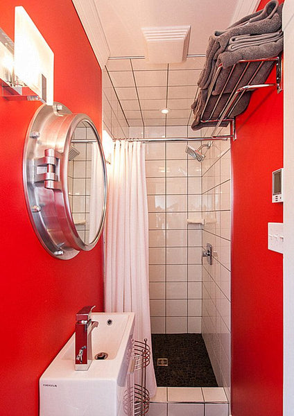 narrow modern bathroom with bright red and white walls, white and chrome accents... Red Bathroom Inspiration from Bathroom Bliss by Rotator Rod