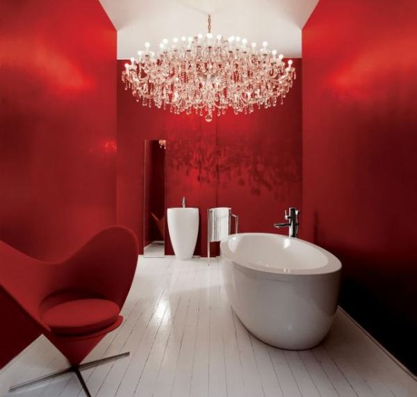 modern red and white bathroom with oval freestanding bathtub, red winged chair, white tile floor, amazing chandelier... Red Bathroom Inspiration from Bathroom Bliss by Rotator Rod