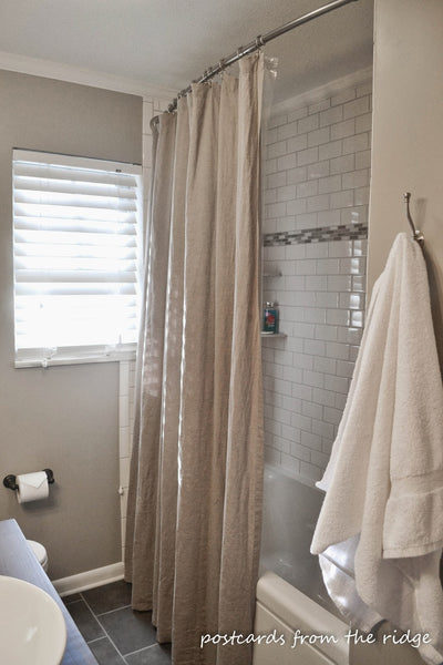 small but beautiful beige bathroom with curved shower rod... Should You Change Your Shower Rod for Winter? from Bathroom Bliss by Rotator Rod