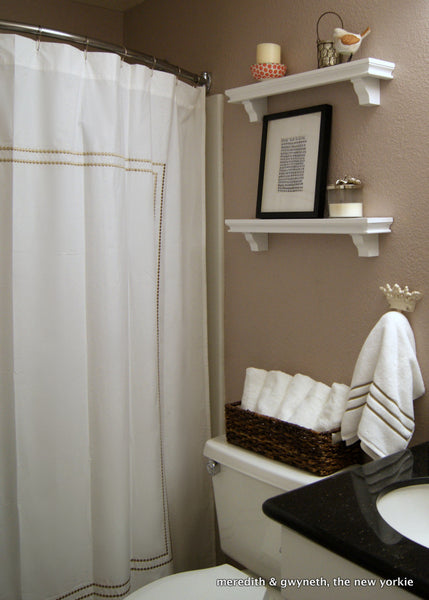 small but lovely beige bathroom with white shower curtain and curved shower rod... Should You Change Your Shower Rod for Winter? from Bathroom Bliss by Rotator Rod