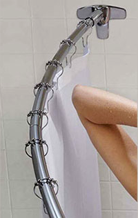 you can see the elbow space you gain in the shower with a curved shower rod... Should You Change Your Shower Rod for Winter? from Bathroom Bliss by Rotator Rod