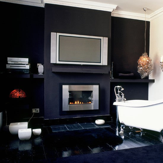 contemporary masculine bathroom with clawfoot bathtub, fireplace, and tv... Sleek & Sexy Black Bathroom Designs from Bathroom Bliss by Rotator Rod