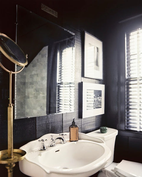 masculine bathroom with porcelain sink, artwork, and gold accents... Sleek & Sexy Black Bathroom Designs from Bathroom Bliss by Rotator Rod