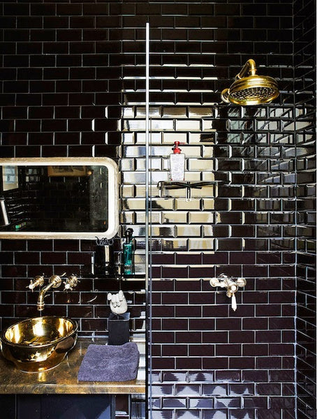 gorgeous bathroom shower with glossy black tile and gold accents... Sleek & Sexy Black Bathroom Designs from Bathroom Bliss by Rotator Rod