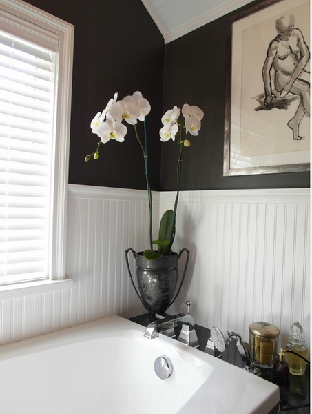 black and white bathroom with bathtub, orchid flowers and artwork... Sleek & Sexy Black Bathroom Designs from Bathroom Bliss by Rotator Rod
