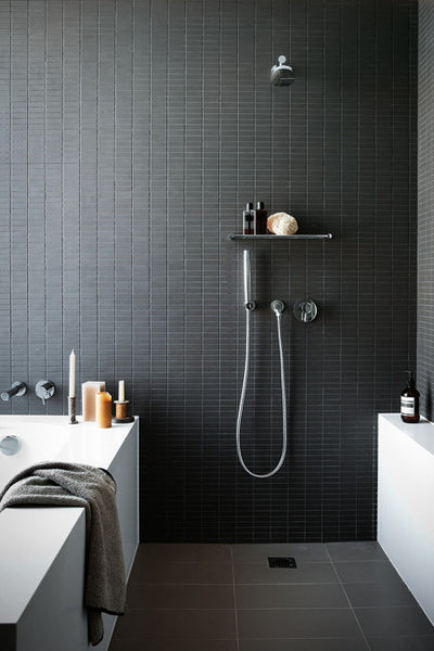 sleek modern bathroom with dark wall tile, shower, and bathtub... Sleek & Sexy Black Bathroom Designs from Bathroom Bliss by Rotator Rod