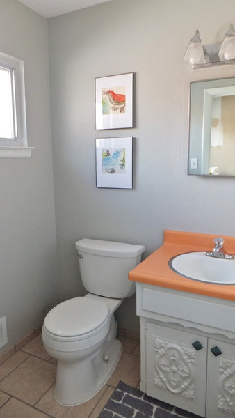 small gray bathroom with bird prints, antique cabinets... Small Bathroom Chic: Artwork Brightens Bathroom Space from Bathroom Bliss by Rotator Rod
