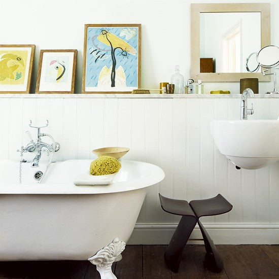 small white bathroom with claw footed tub and artwork on display... Small Bathroom Chic: Artwork Brightens Bathroom Space from Bathroom Bliss by Rotator Rod