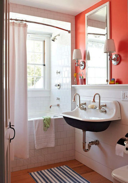 small white bathroom with coral accent wall, wood floor, curved shower rod... Small Bathroom Chic: Small Spaces with Big Style from Bathroom Bliss by Rotator Rod