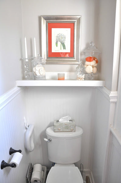 small gray and white toilet area with shelves and coral artwork... Small Bathroom Chic: Small Spaces with Big Style from Bathroom Bliss by Rotator Rod