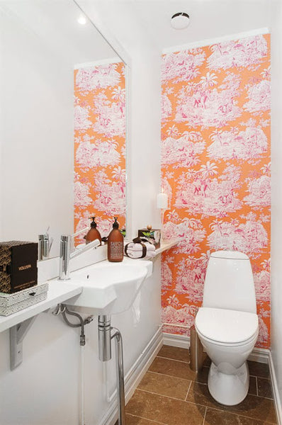 small white bathroom with pink and orange wallpaper accent wall... Small Bathroom Chic: Small Spaces with Big Style from Bathroom Bliss by Rotator Rod