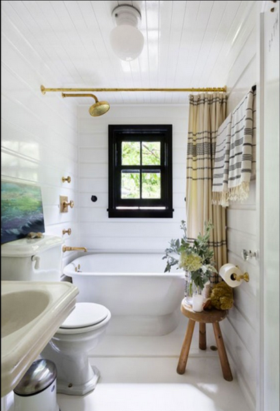small but elegant white bathroom with ocean painting, shower curtain... Small Bathroom Chic: Small Spaces with Big Style from Bathroom Bliss by Rotator Rod