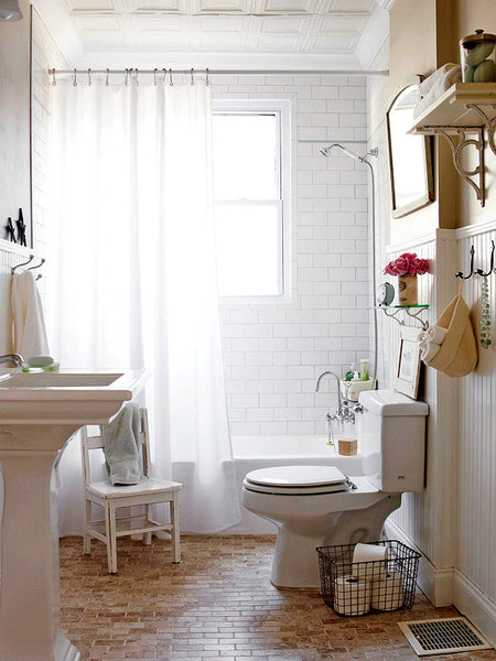 Small White And Airy Bathroom With White Shower Curtain, Wood Floor... Small