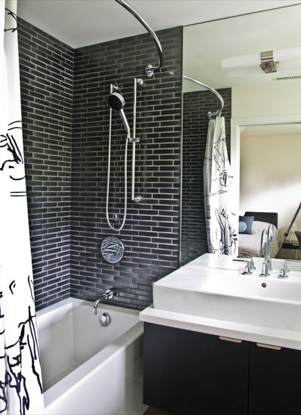 small black and white bathroom with black subway tile, curved shower rod... Small Bathroom Ideas: Shower Spaces from Bathroom Bliss by Rotator Rod