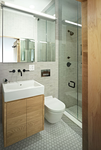 small white bathroom with light wood accents, glass shower doors... Small Bathroom Ideas: Shower Spaces from Bathroom Bliss by Rotator Rod
