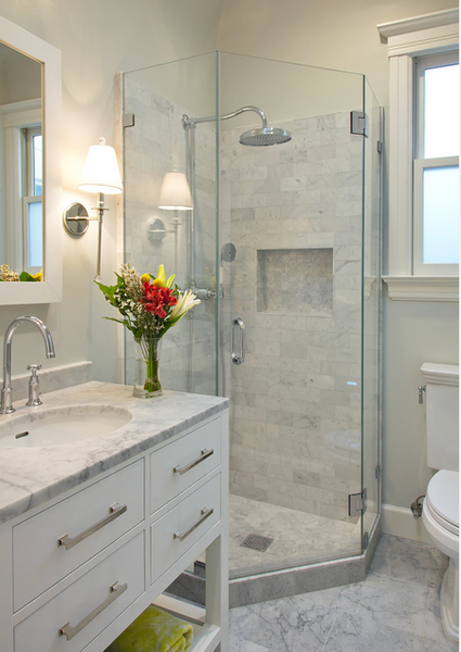 small white bathroom with marble tile, white cabinets, glass shower doors, flowers... Small Bathroom Ideas: Shower Spaces from Bathroom Bliss by Rotator Rod